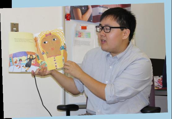 Man reading book to children